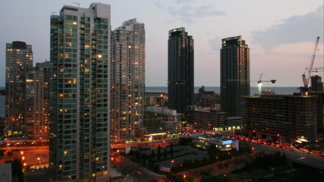 A time lapse from day to night shows the dramatic illumination of the Cityplace Condominium development in Toronto, Canada.