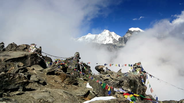 time lapse from the top of gokyo ri in nepal - buddhism stock videos & royalty-free footage