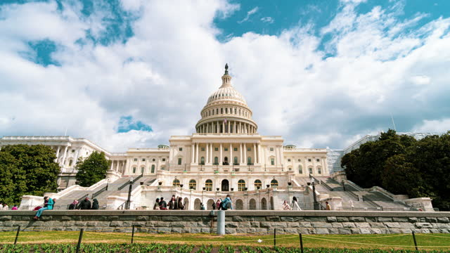 time lapse front of the united states capitol building, capitol hill, washington, d.c., usa - parliament building stock videos & royalty-free footage