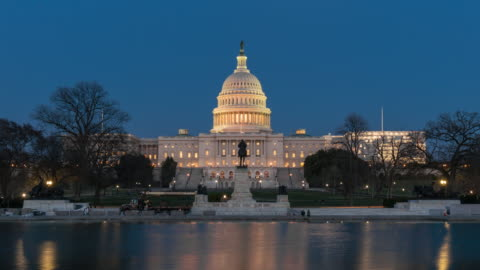 4k time lapse front of the united states capitol building with reflecting pool at twilight time, capitol hill, washington, d.c., usa - capital cities stock videos & royalty-free footage