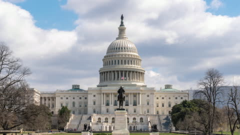 4k time lapse front of the united states capitol building with reflecting pool, capitol hill, washington, d.c., usa, architecture and attraction concept - washington monument washington dc stock videos & royalty-free footage