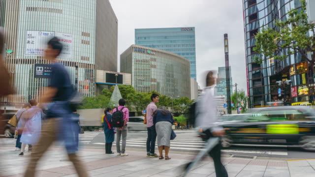 4kタイムラプス.東京の銀座交差点、 日本 - 十字架点の映像素材/bロール