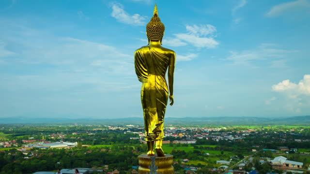 Tidsfördröjning: Gyllene buddhastaty