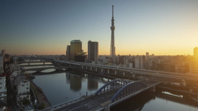 4k time lapse golden time with tokyo sky tree in sunrise wide angle view with sumida river - asakusa tokyo japan - tokyo japan video stock e b–roll