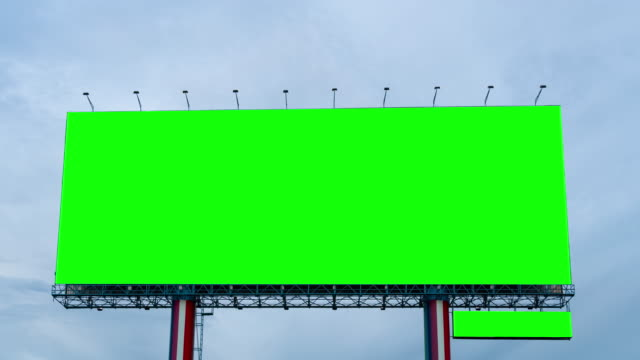 time lapse : green screen of billboard on blue sky - tabellone video stock e b–roll