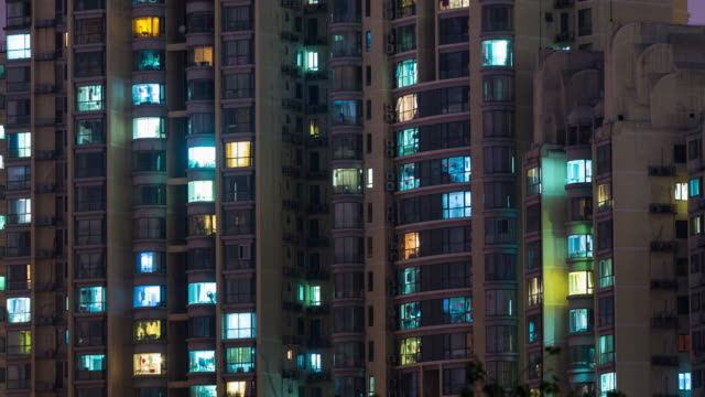 stockvideo's en b-roll-footage met tijd lapse - grid appartement in peking (pan) - gevel