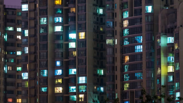 vídeos de stock e filmes b-roll de time lapse- grid apartment in beijing (cu pan) - janela