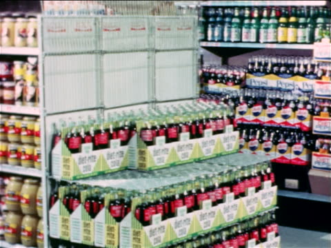 1965 time lapse grocery store shelf filling up with six-packs of bottled soda / educational - regal stock-videos und b-roll-filmmaterial