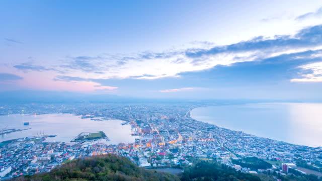 4 k の時間経過函館市北海道函館山の夜景の日 - 町点の映像素材/bロール