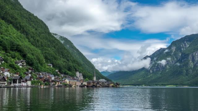 4k time lapse : hallstatt mountain village landscape famous view - salzkammergut stock videos and b-roll footage