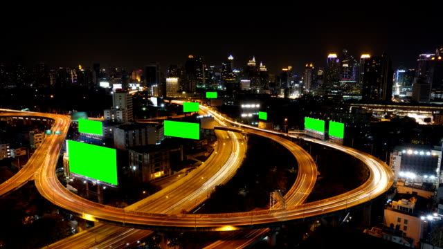 Time Lapse HD:  High Angle view Traffic and Central Business District of Bangkok nightscape.