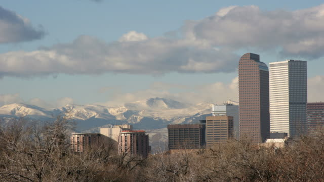 time lapse hd video clouds over denver and mountains - denver stock videos and b-roll footage