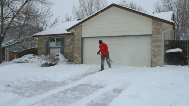 Time lapse HD video man snow shoveling Denver Colorado home