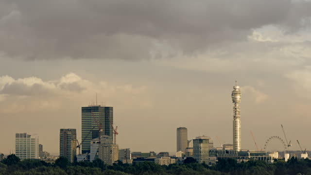 time lapse heavy clouds over london skyline. - bt tower london stock videos & royalty-free footage