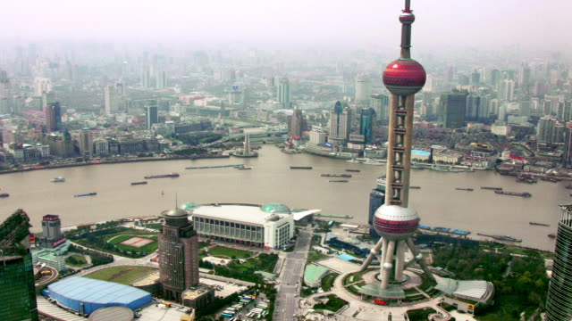 time lapse high angle barges passing oriental pearl tv tower (view from jin mao tower) / huangpu river / shanghai - pearl stock videos and b-roll footage