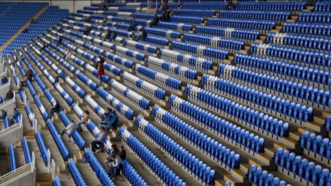 time lapse high angle long shot crowd arriving at stadium / taking seats in stands - filling stock videos & royalty-free footage