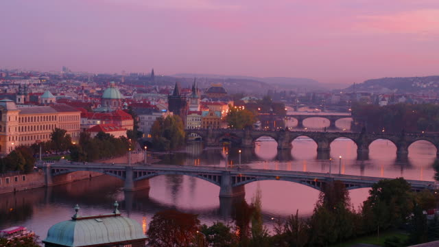 Time lapse high angle long shot Manesuv, Charles, Legii and Jiraskuv bridges over Vltava at twilight / Prague
