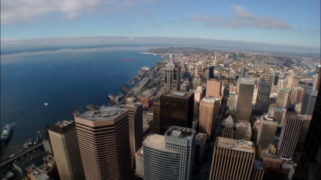 time lapse high angle long shot of skycrapers in downtown seattle and elliot bay / washington state - washington mutual tower stock videos & royalty-free footage