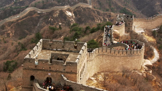 Time lapse high angle long shot tourists climbing and descending the stairs of the Great Wall at Badaling / China