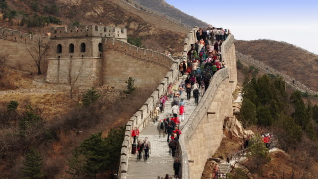 time lapse high angle tourists climbing and descending the stairs of the great wall at badaling / china - badaling great wall stock videos & royalty-free footage