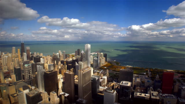 time lapse high angle view from the sears tower of clouds passing over downtown chicago and lake michigan / chicago, illinois - two prudential plaza stock videos & royalty-free footage