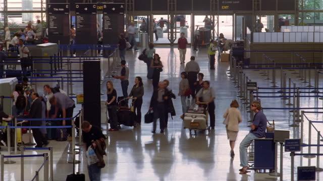time lapse high angle wide shot passengers walking through terminal at lax / los angeles - lax airport stock videos & royalty-free footage
