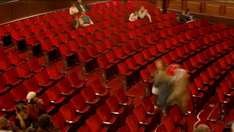 time lapse high angle wide shot theater filling up for performance / london - filling stock videos & royalty-free footage