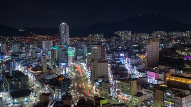 4k time lapse : high rise skyscraper buildings,modern city business district background night in busan, south korea cityscape panorama,cityscape of jung-gu district - busan stock videos & royalty-free footage