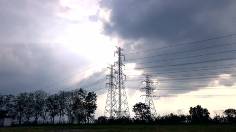 time lapse: high voltage electricity tower with cloud and sky sunset - high voltage sign stock videos & royalty-free footage