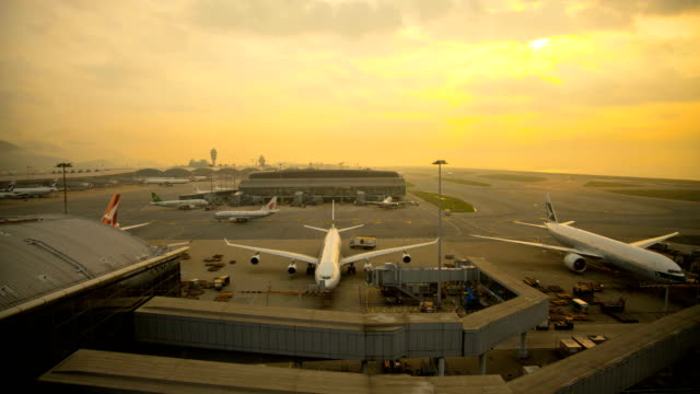 time lapse hong kong international airport sunset china - china east asia stock videos & royalty-free footage