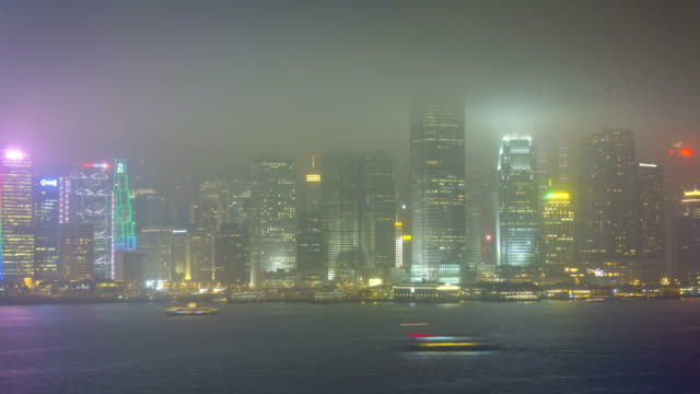 Time lapse Hong Kong Promenade illuminated Victoria Harbour