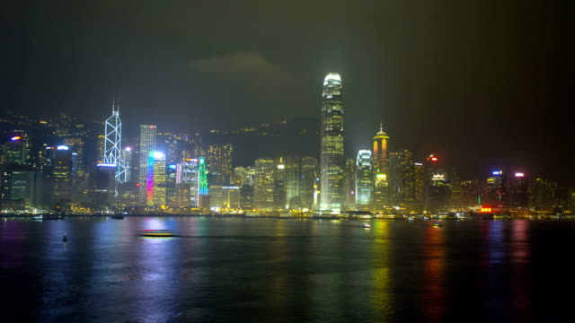 time lapse hong kong victoria harbour illuminated city - bank of china tower hong kong stock videos & royalty-free footage