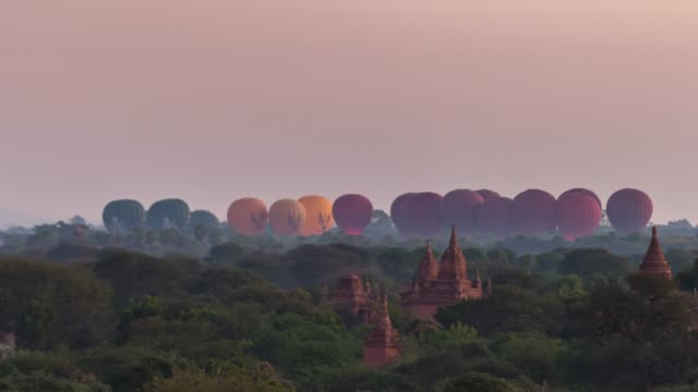 4K Time lapse : Hot Balloons flying over Bagan Temples ,Old Pagoda in Bagan Myanmar
