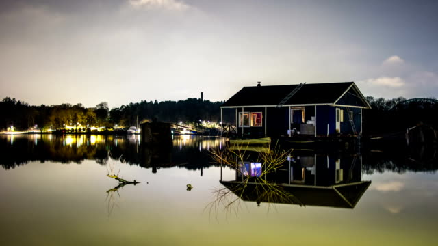 hd time lapse: houseboat at night - log cabin stock videos & royalty-free footage
