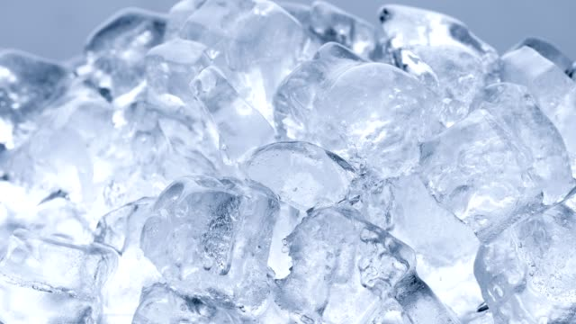 time lapse ice cube melts, global warming concept - ice stock videos & royalty-free footage