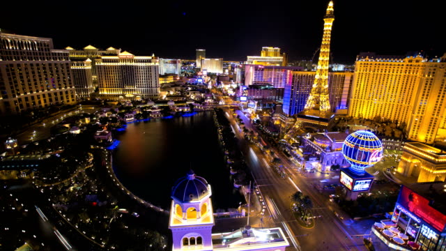 time lapse illuminated eiffel tower traffic las vegas - the strip las vegas stock-videos und b-roll-filmmaterial