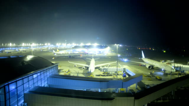 time lapse illuminated hong kong international airport china - china east asia stock videos & royalty-free footage