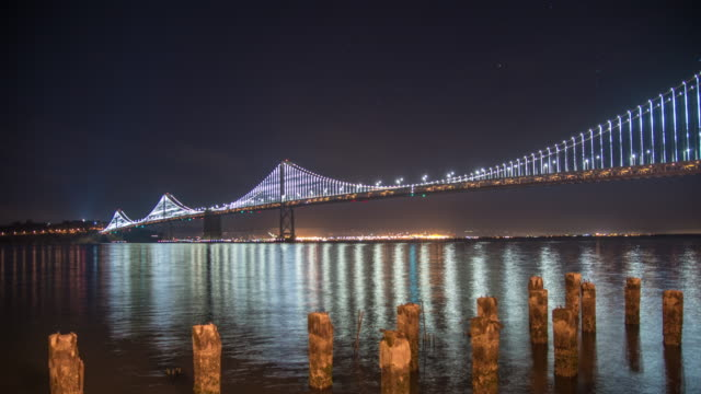 ws time lapse illuminated san francisco oakland bay bridge at night,california,united states - san francisco oakland bay bridge stock videos and b-roll footage