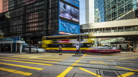 time lapse in a busy pedestrian crossing at central district in hong kong - hong kong island stock videos & royalty-free footage