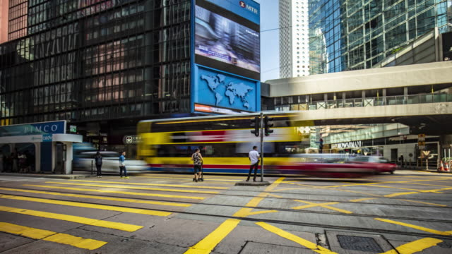 time lapse in a busy pedestrian crossing at central district in hong kong - panning stock videos & royalty-free footage