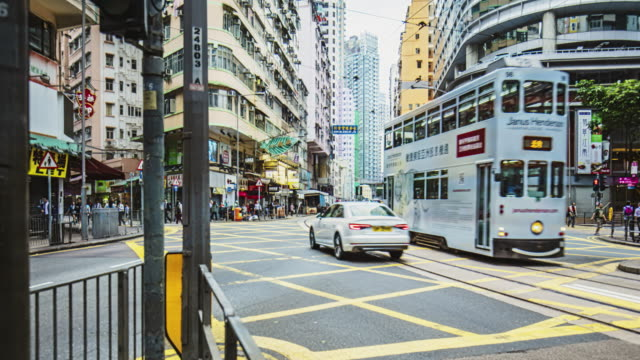 time lapse in a busy pedestrian crossing at wan chai district in hong kong - wanchai stock videos and b-roll footage