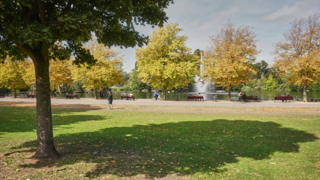 a time lapse in victoria park, east london - fountain stock videos & royalty-free footage
