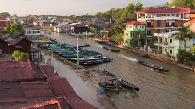 4K Time Lapse : Inle city with boats for tourist travel in Inle lake