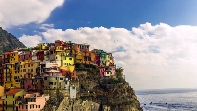 time lapse italian seaside village apartments built into cliff - italien stock-videos und b-roll-filmmaterial