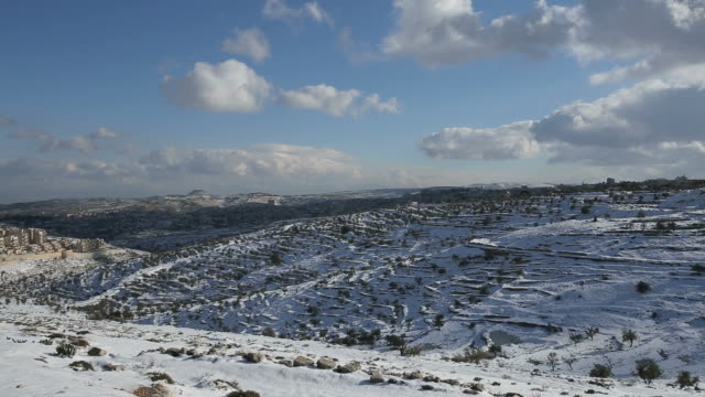 Time Lapse, Judea Mountains with olive trees in winter snow,view from Jerusalem