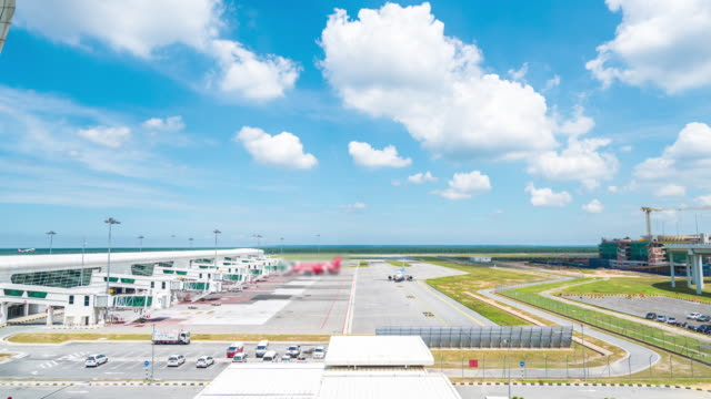 4k time lapse : kl international airport - taxiway stock videos & royalty-free footage