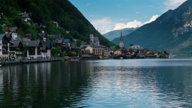 time lapse, landscape and crowd waking at hallstatt village, austria - salzkammergut stock videos and b-roll footage