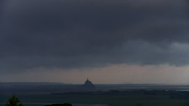 time lapse le mont saint-michel and clouds passing - fast motion time lapse stock videos & royalty-free footage