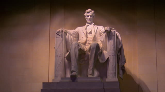 Time lapse light changing on statue of Abraham Lincoln (in Lincoln Memorial) / Washington D.C.