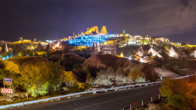 time lapse : light traffic road to   uchisar castle ancient cave houses near goreme, cappadocia, turkey - cliff dwelling stock videos & royalty-free footage